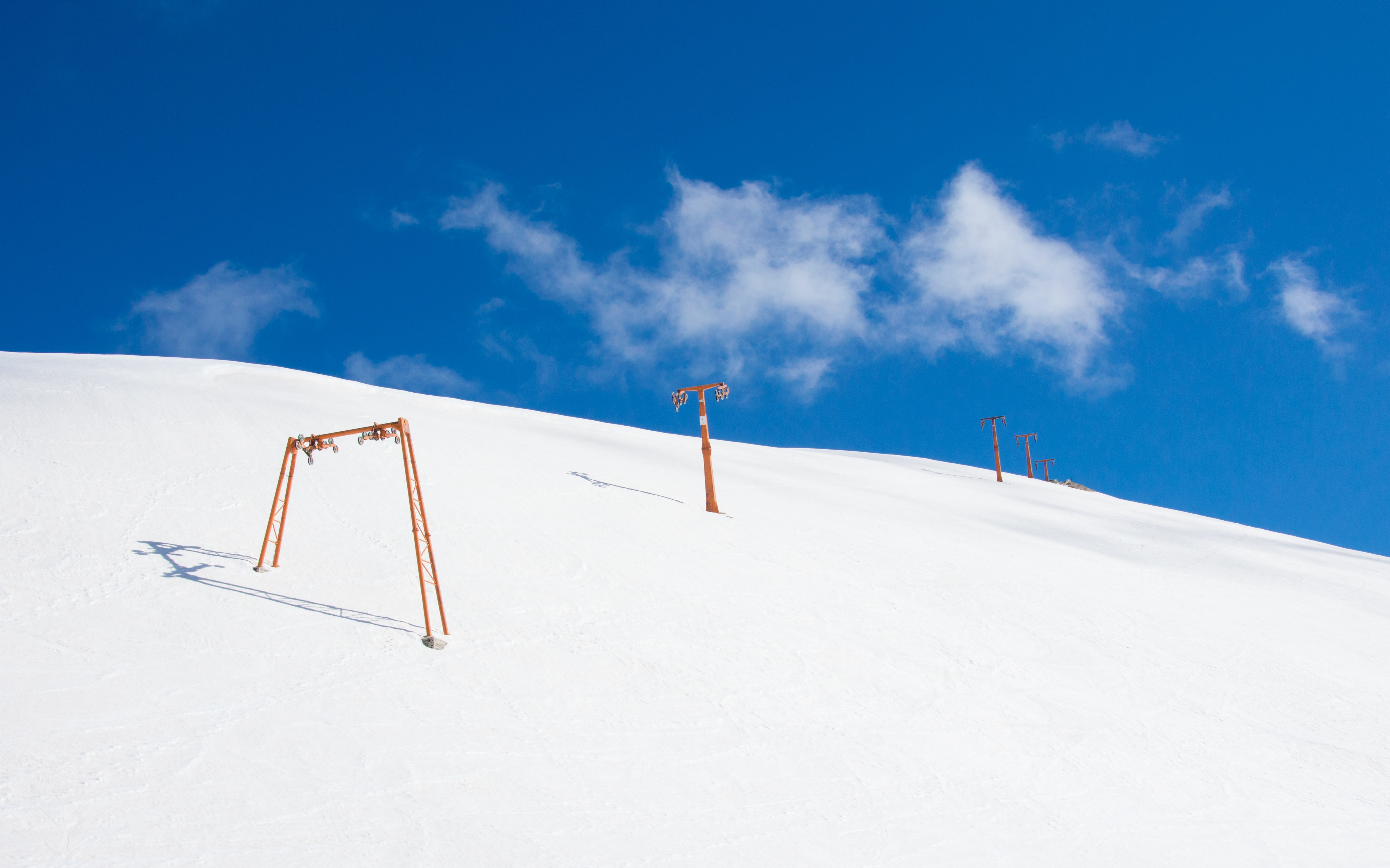 snow mountain with orange pole