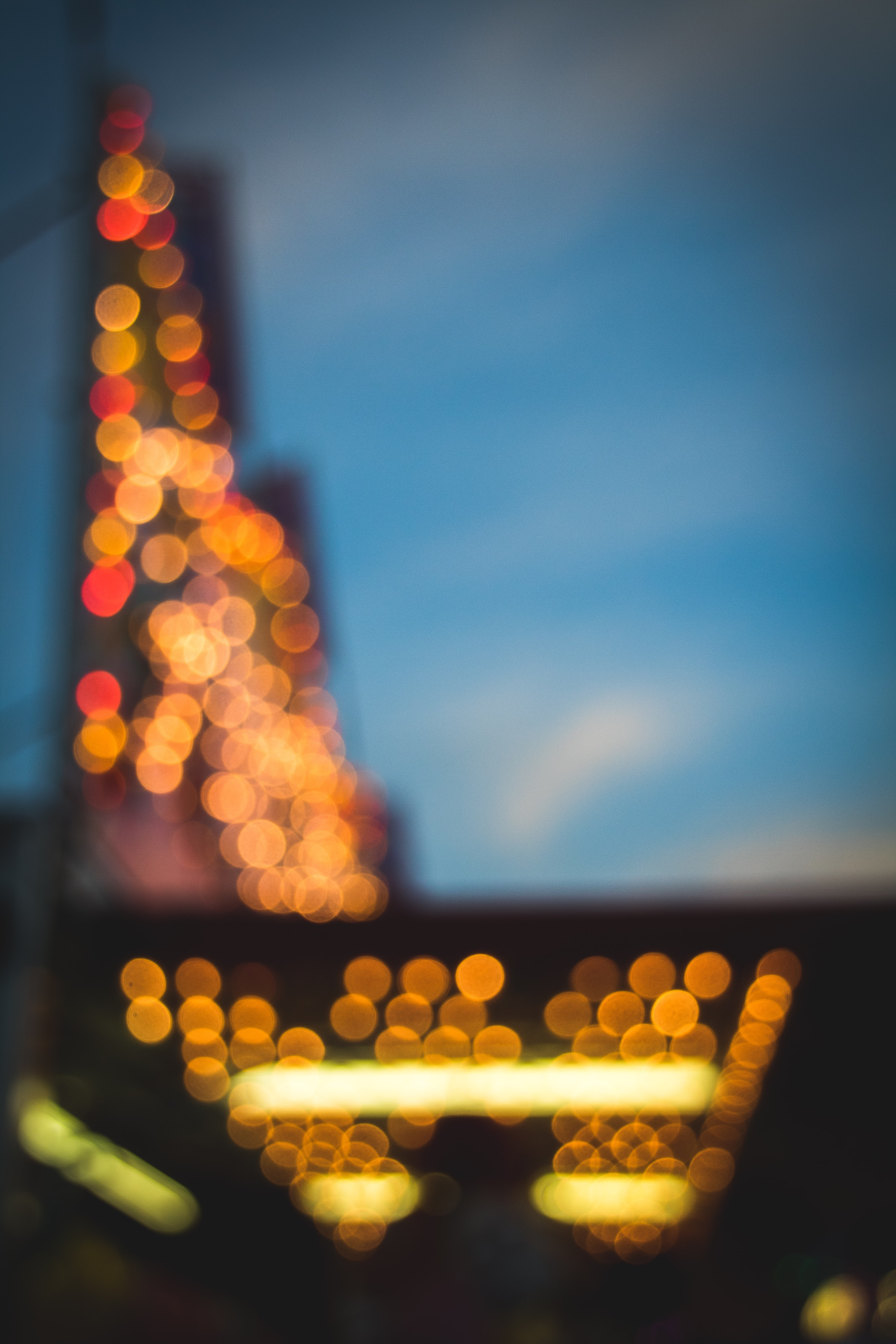 An unfocused shot of bright lights in a tall building with bokeh effect