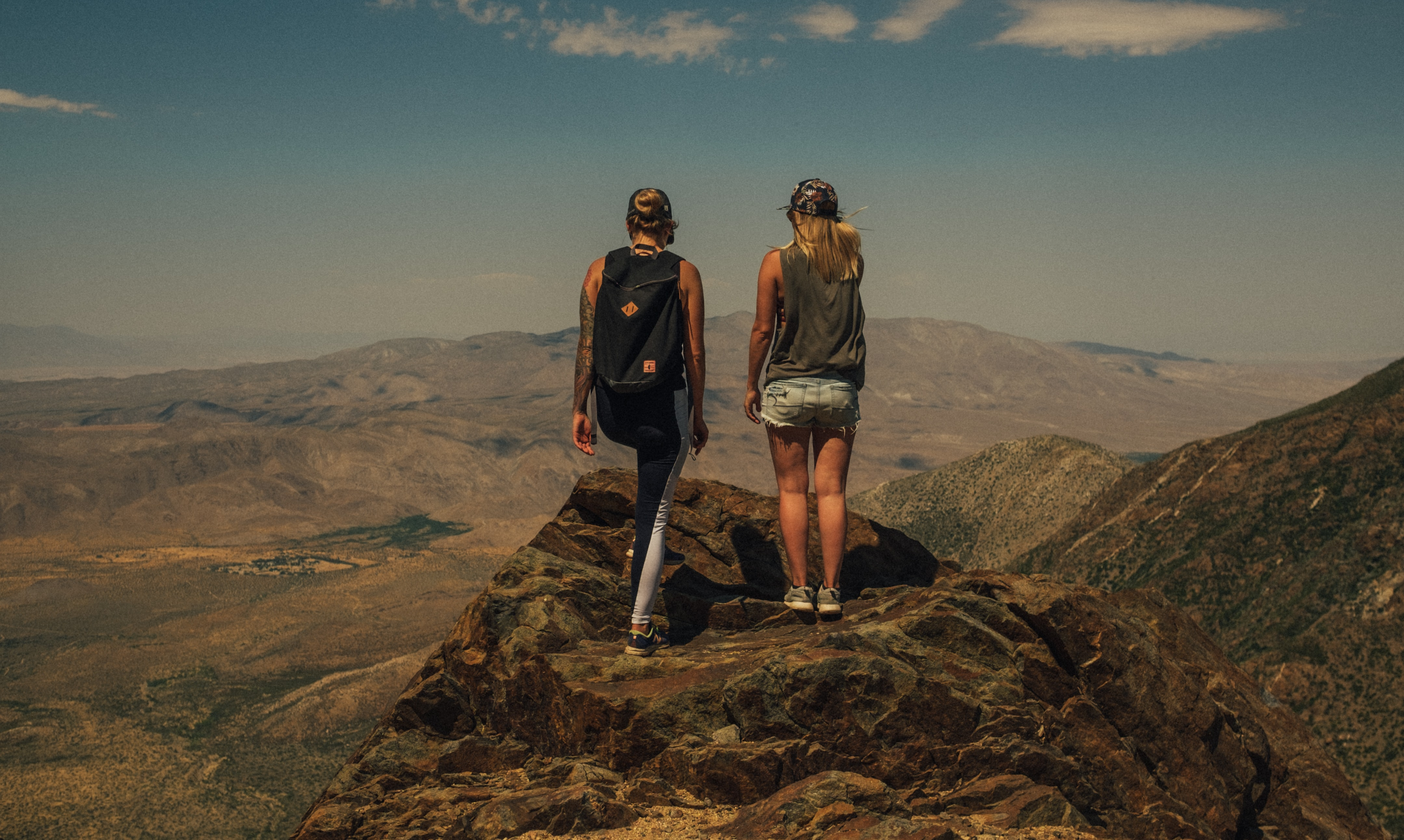 two man and woman standing on mountain top photo