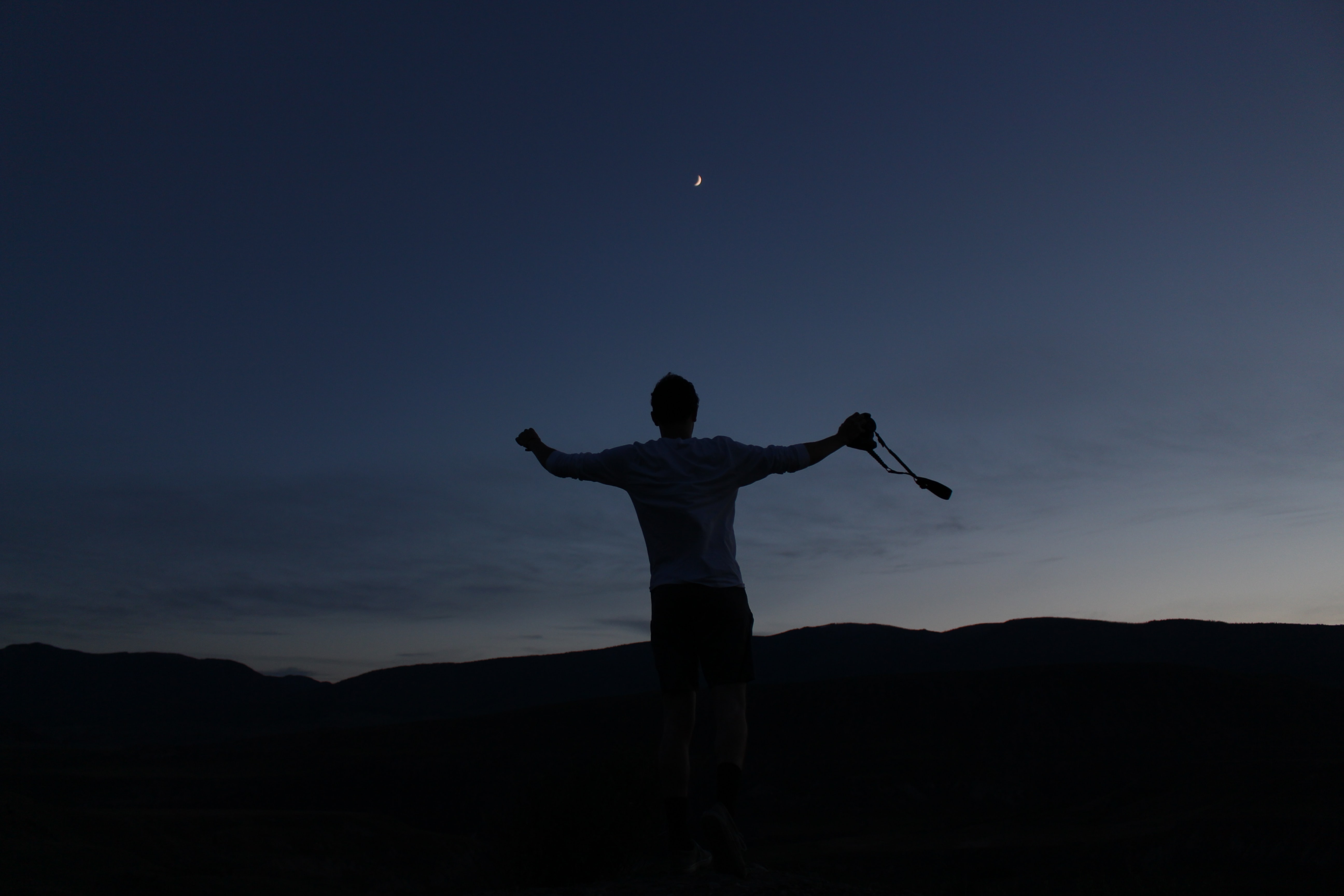 silhouette of man jumping up