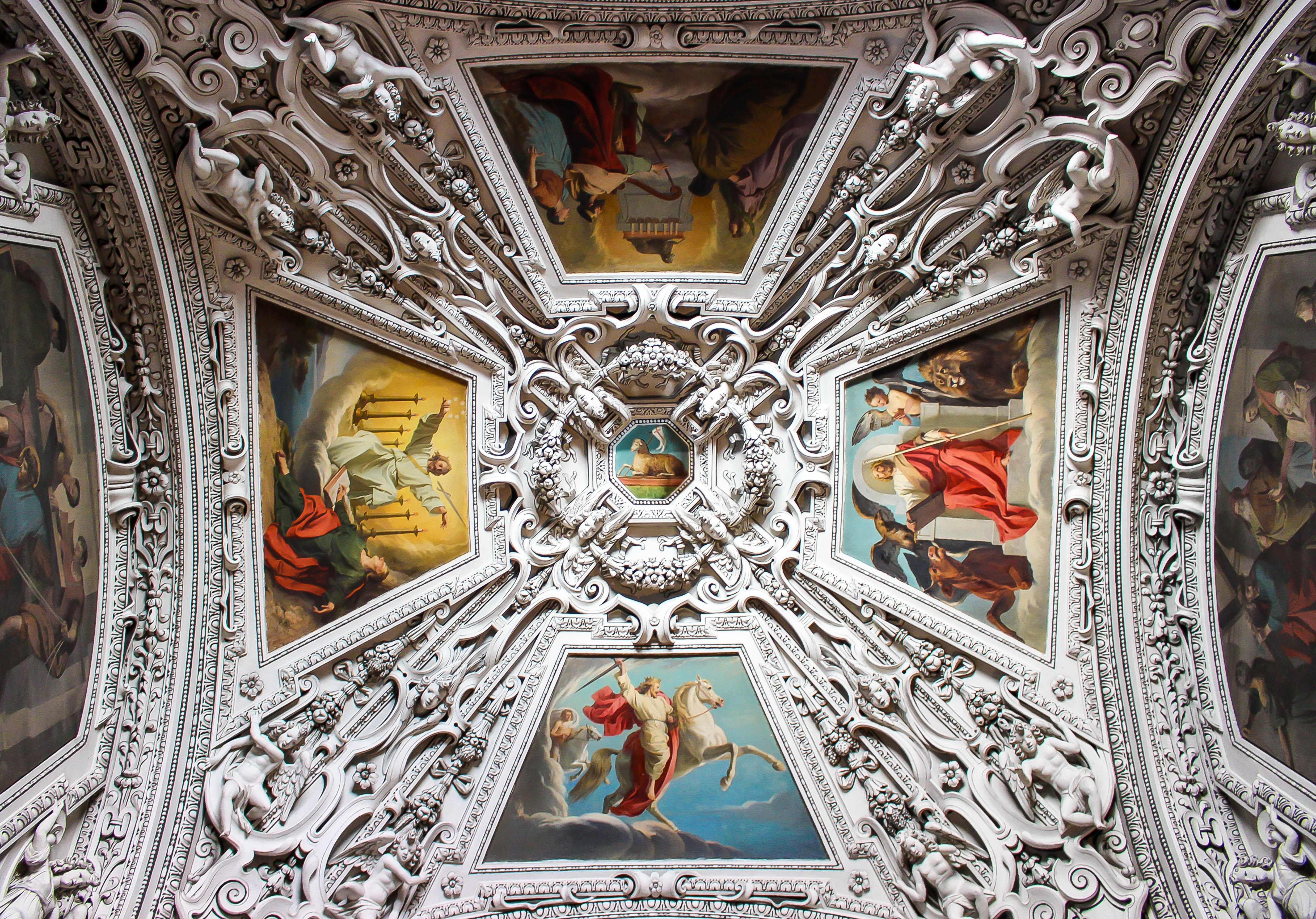 Beautiful ornate ceiling in baroque style with pattern and religious art in Salzburg