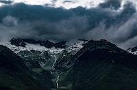 bird's-eye view photography of mountain range under cloudy sky