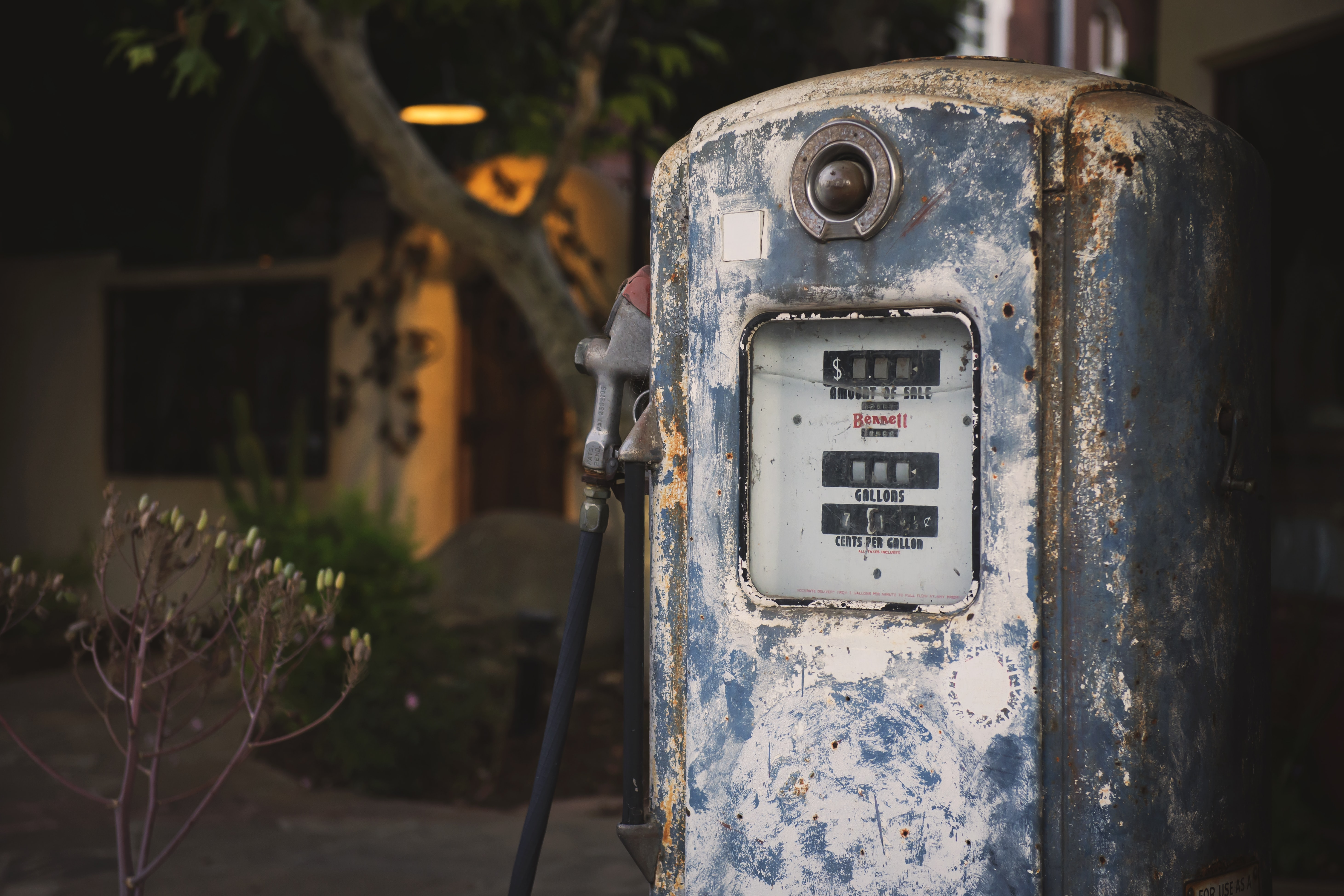 Old, vintage and rusty blue gas pump located at a gas station at Los Alamos.