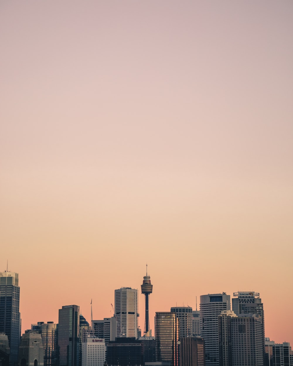 high rise building under orange skies