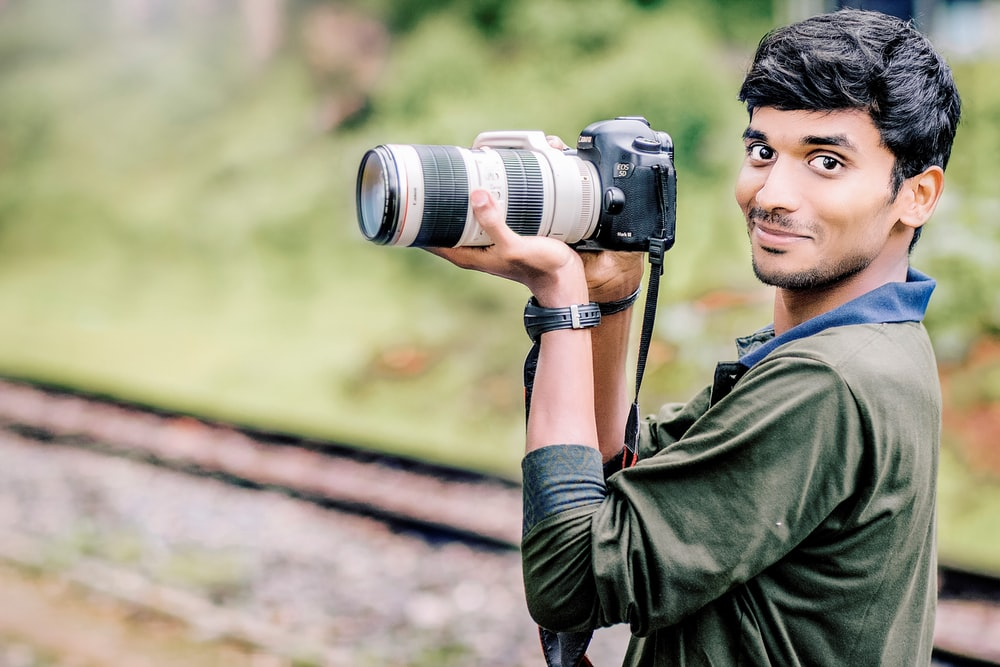 man taking photo in selective focus photography
