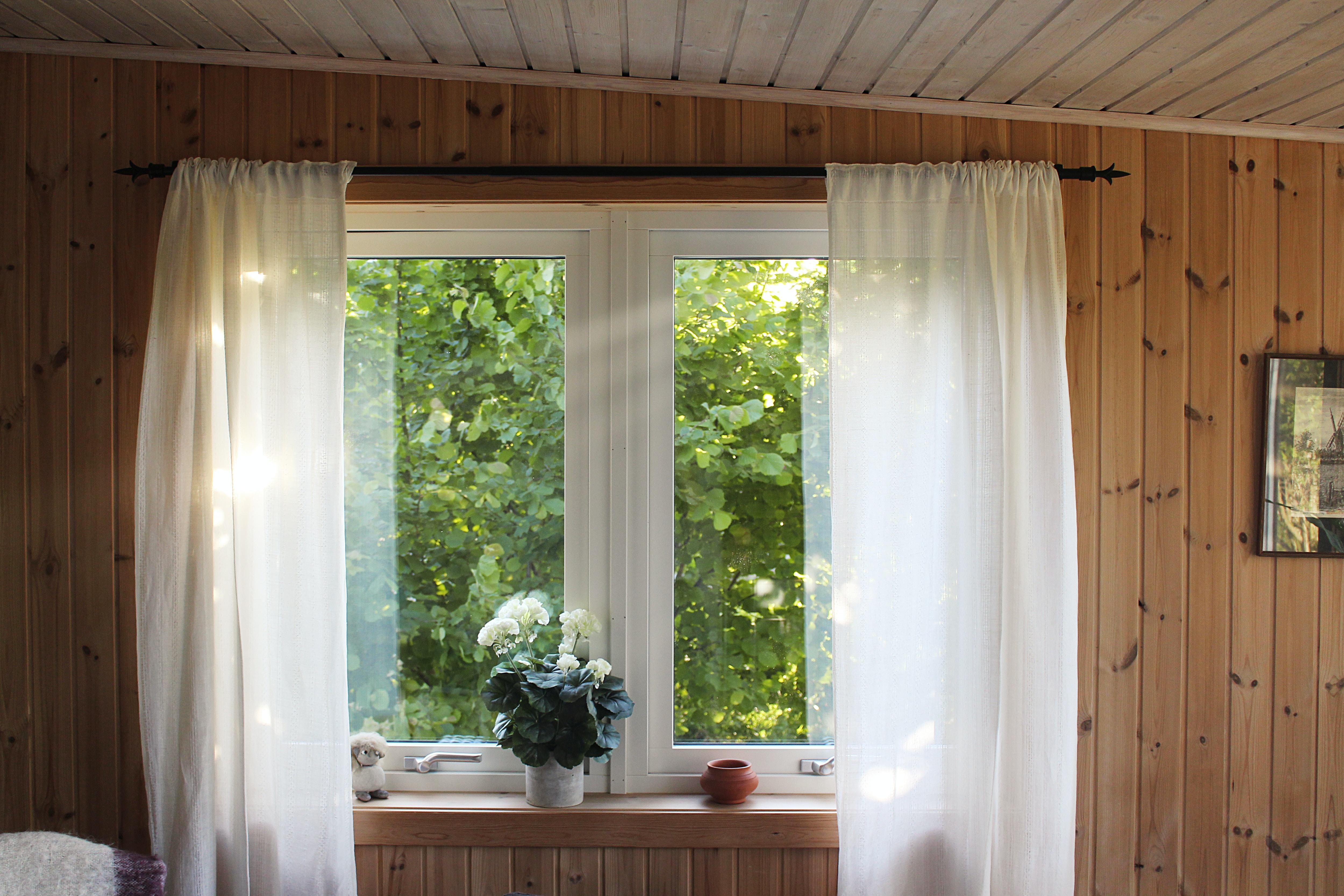 white rod pocket curtain on window frame