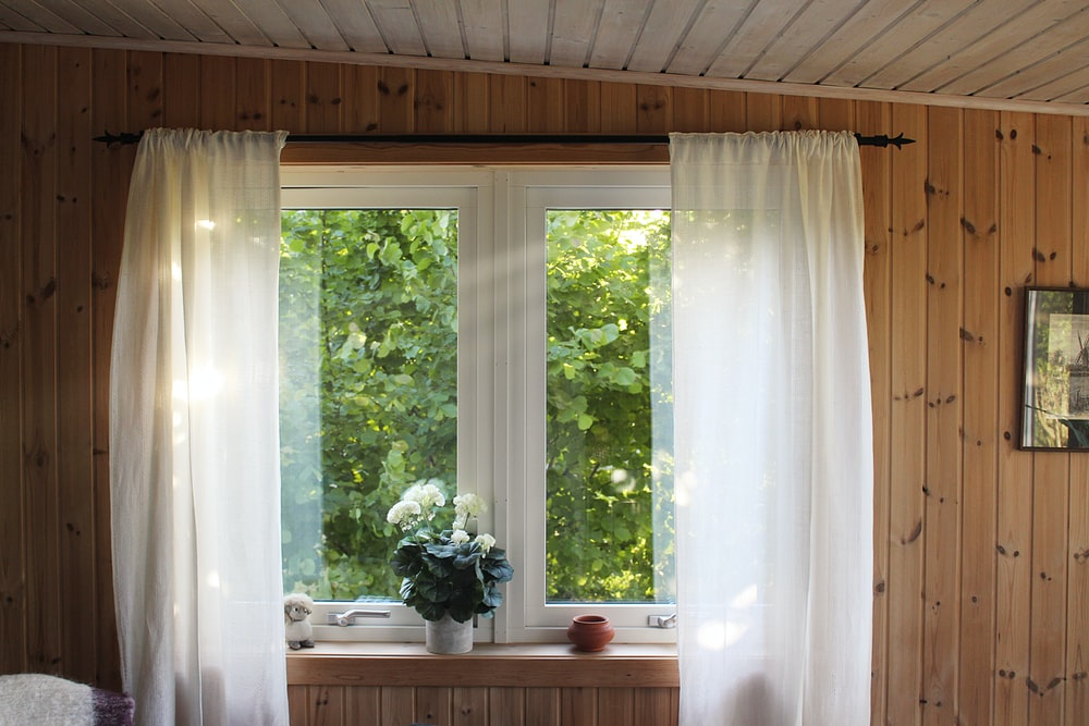 white rod pocket curtain on window frame