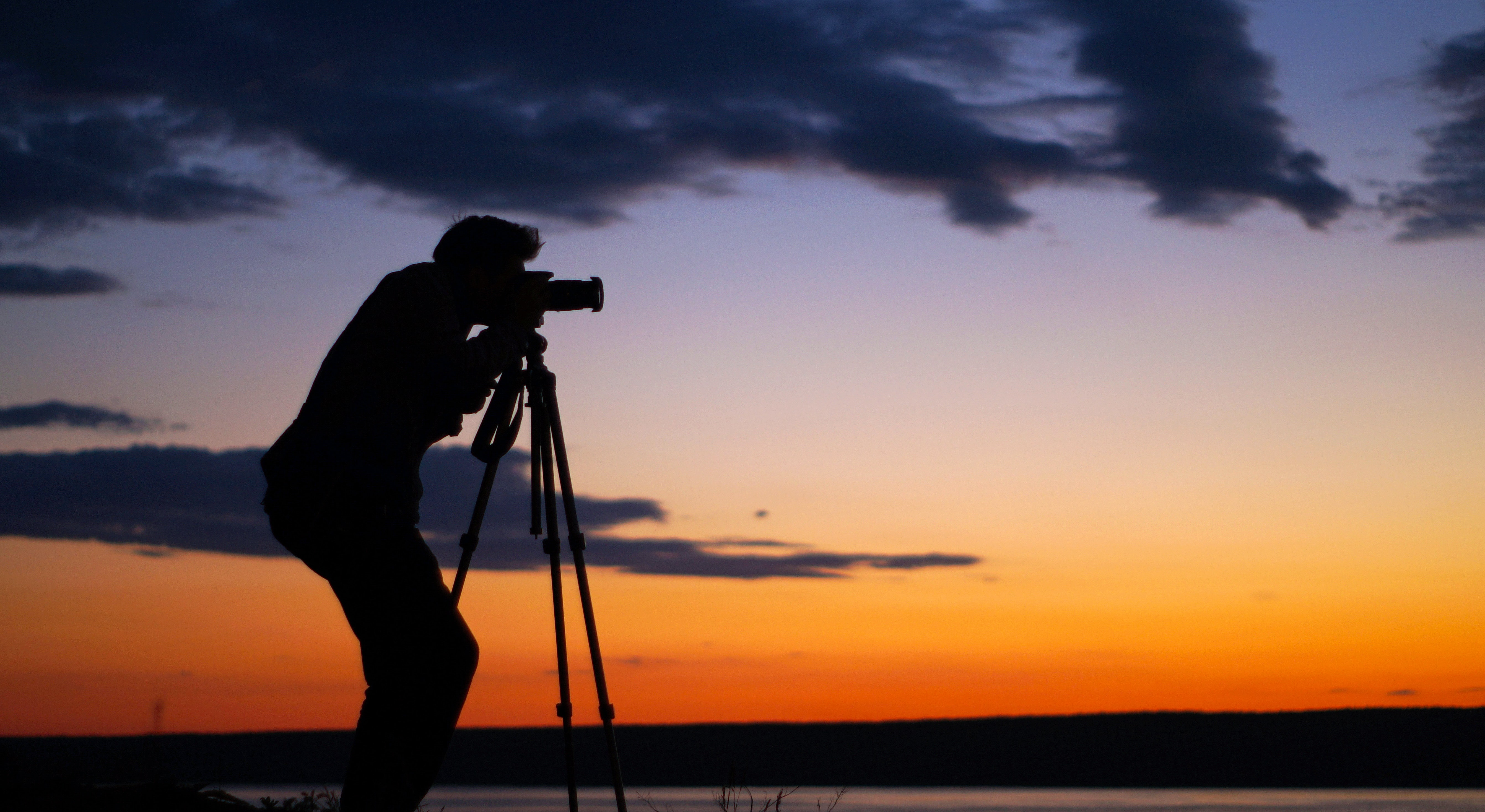 silhouette of man taking picture