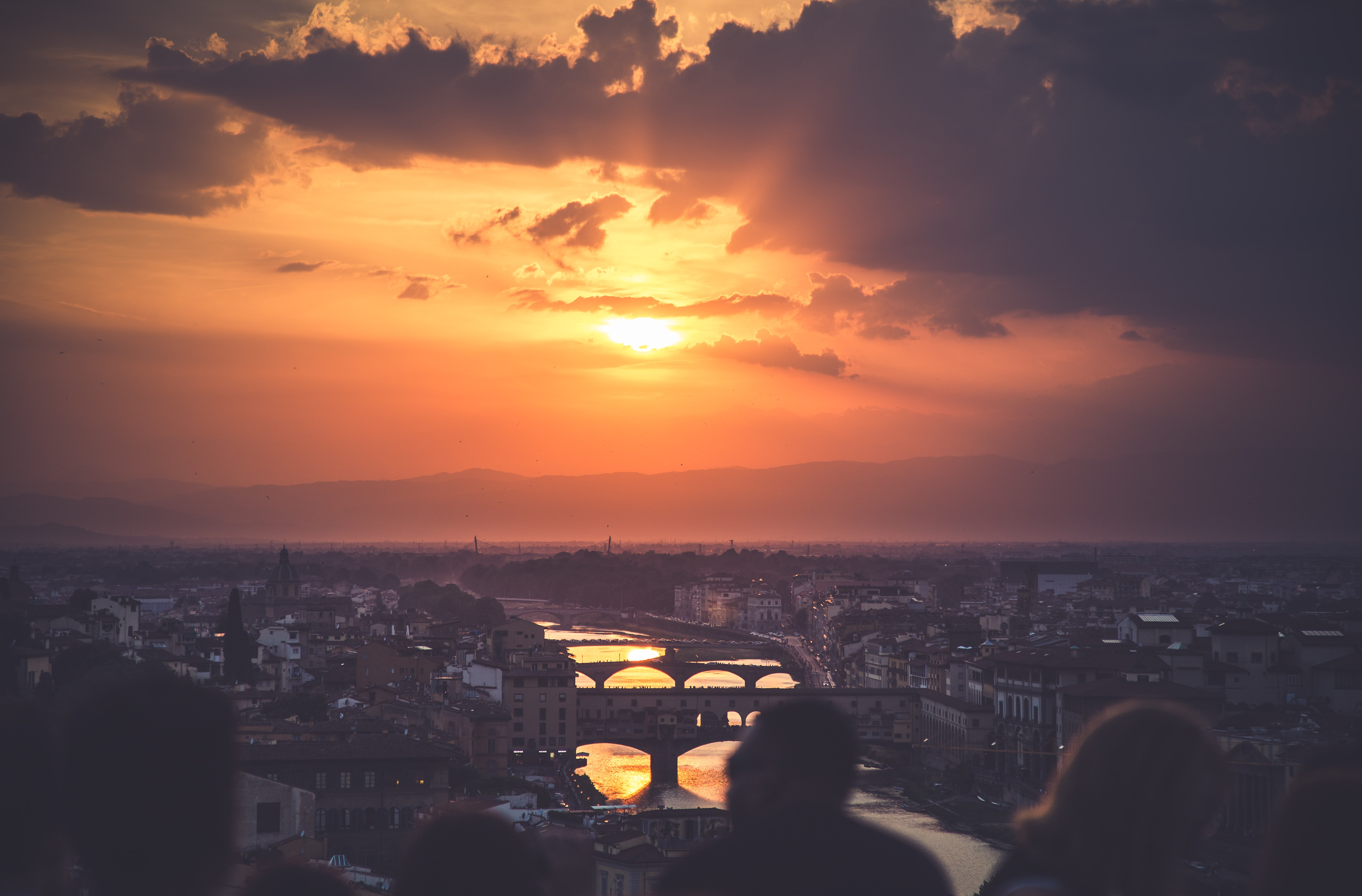 The sun setting over the bridges and the Arno River of Florence, Italy, looking out from Piazzale Michelangelo
