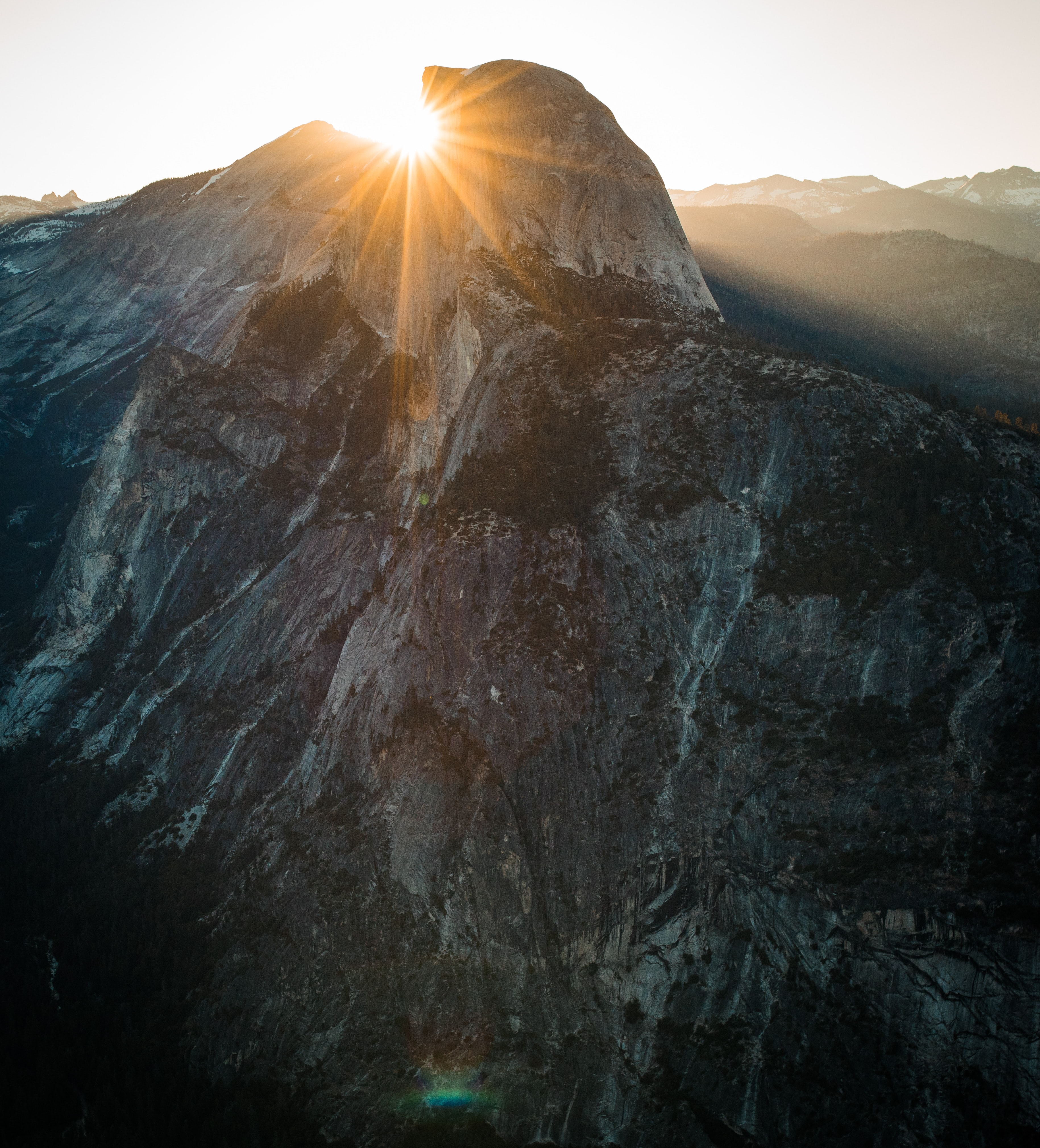 Setting sun behind a cliff in Yosemite National Park