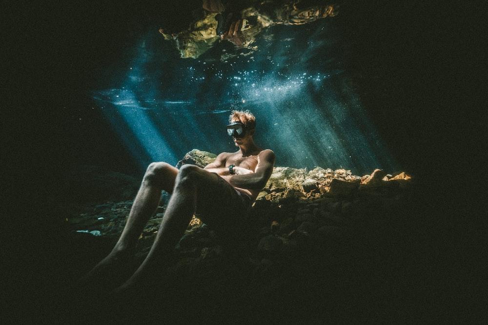 man relaxing under water