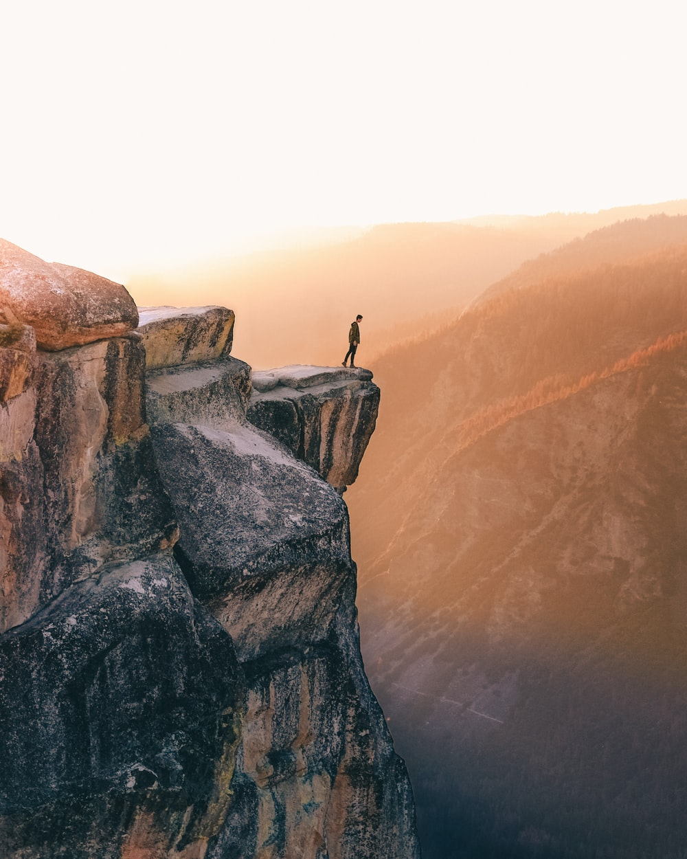 person standing near cliff