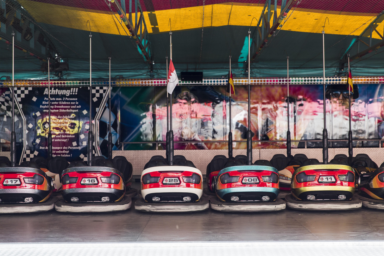 Line of vintage bumper cars at an amusement park