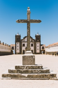 gray concrete cross in front of church