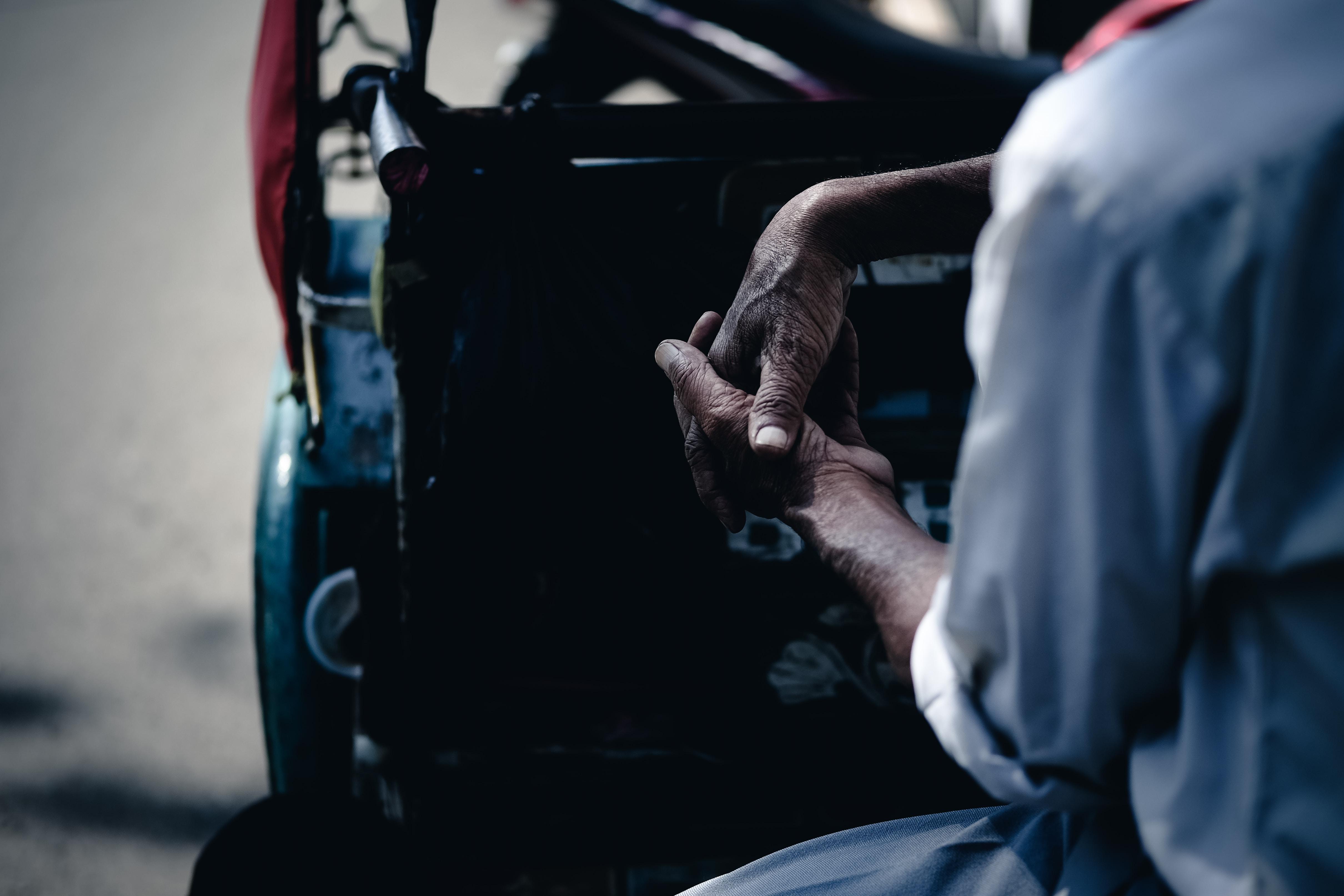 man sitting in auto rickshaw