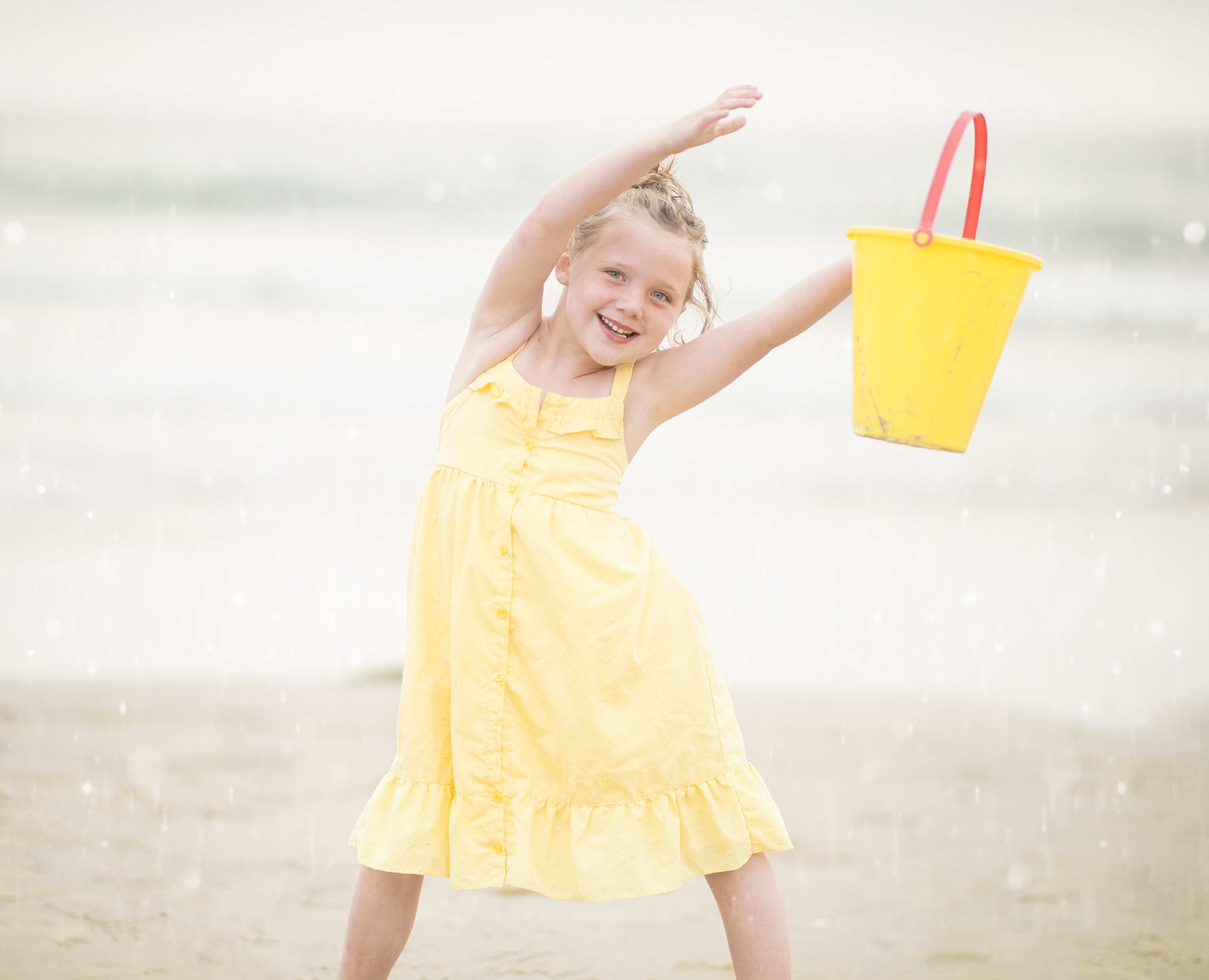 selective focus photography of girl standing near sea shore