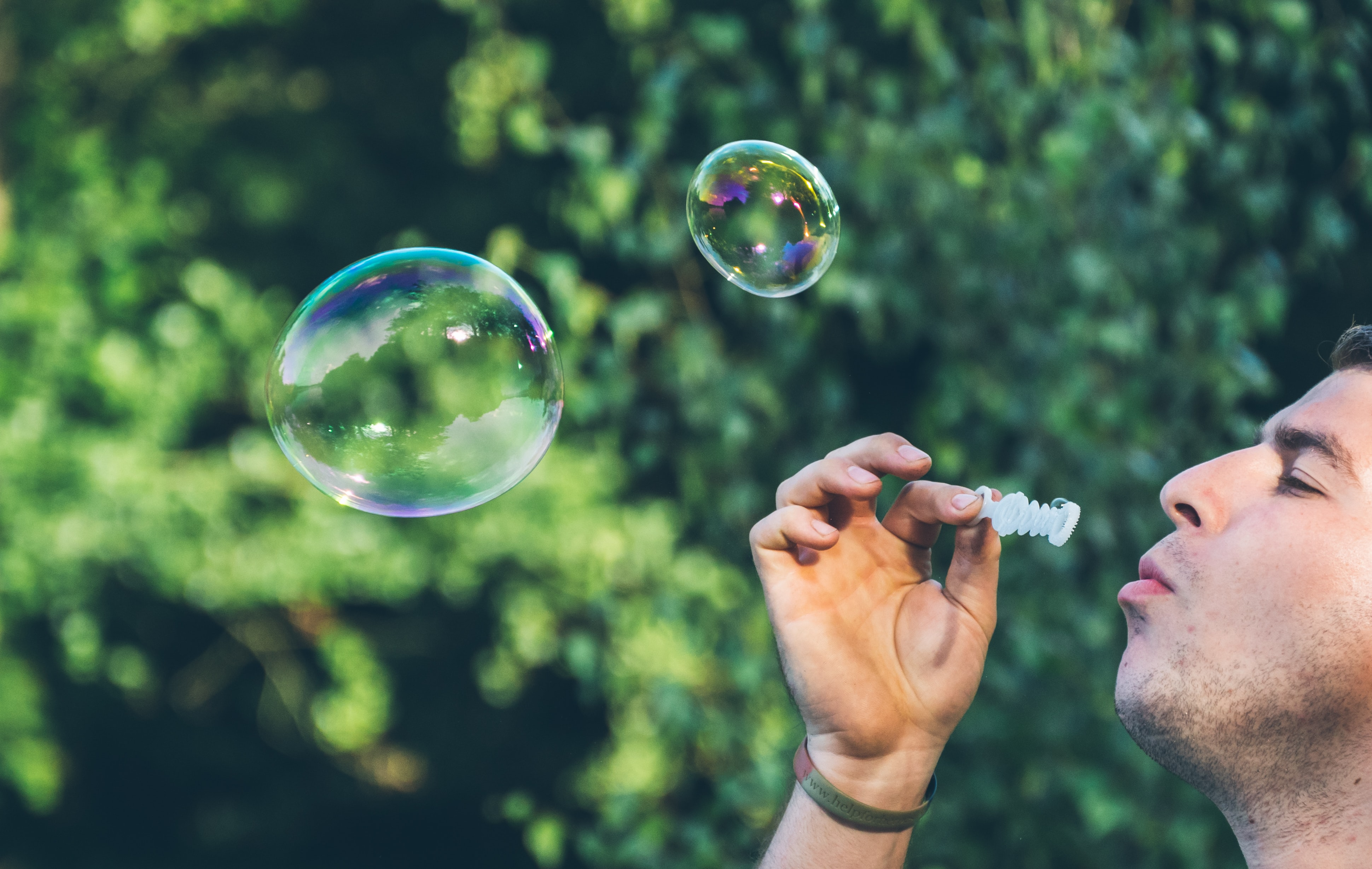 man playing bubbles
