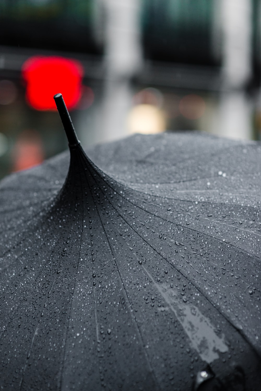 selective focus photography of black umbrella