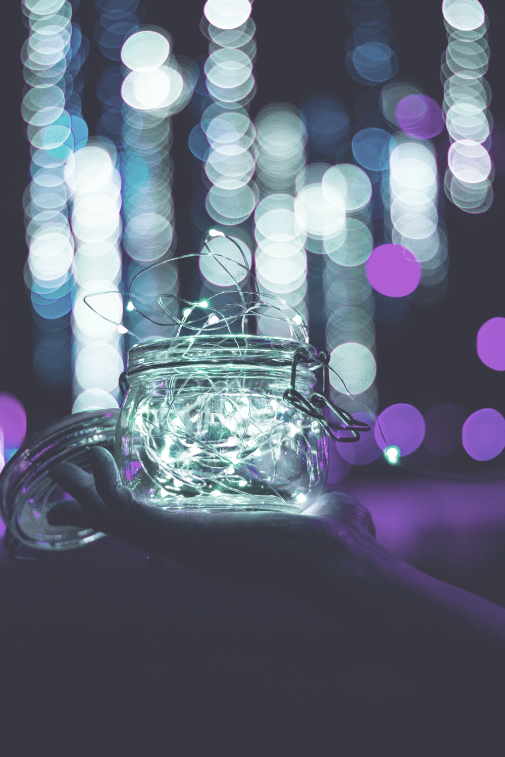 clear glass jar with string lights