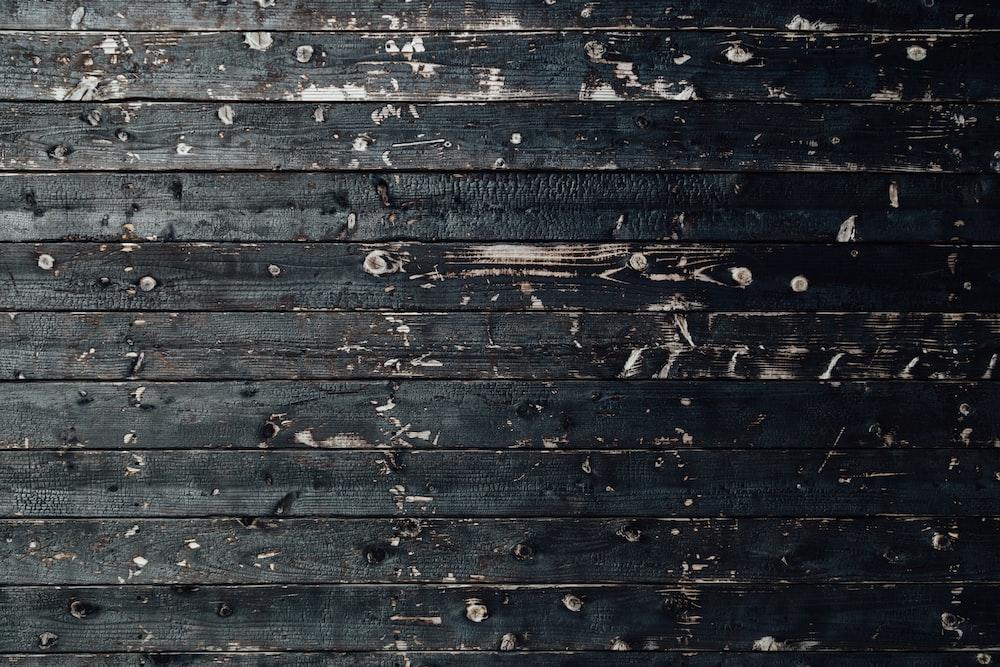 closeup photography of black wooden parquet partition