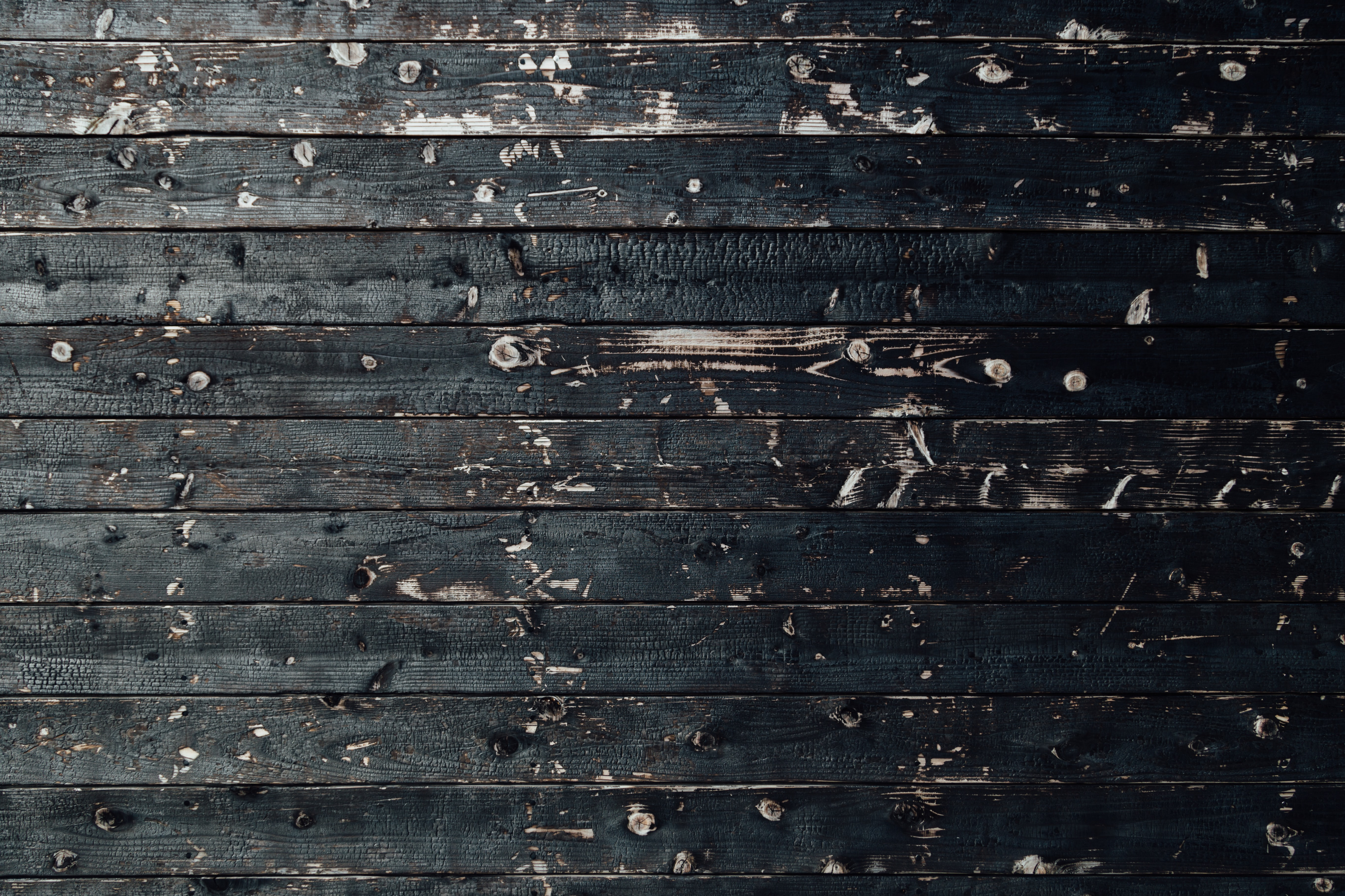 A wall made of long charred planks