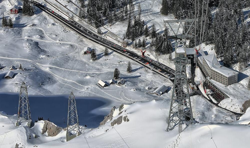 aerial photo of snow terrain near railway during daytime