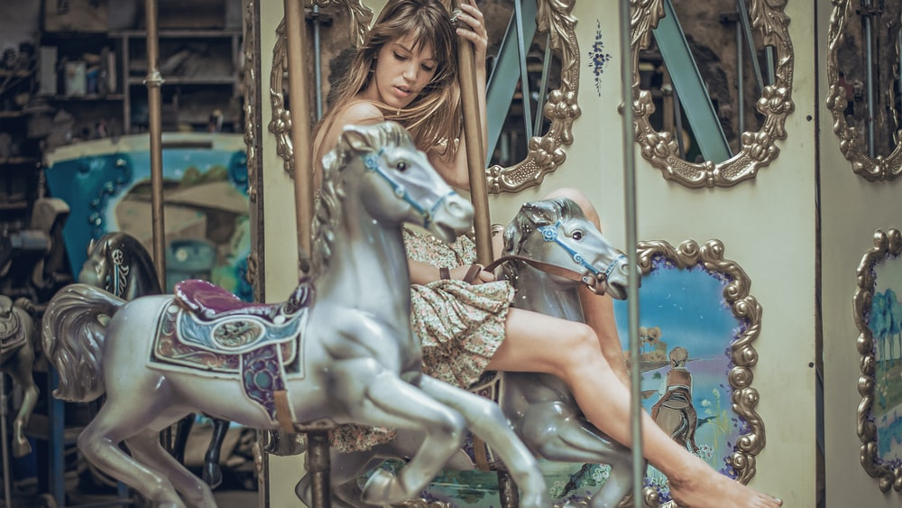 woman riding horse carousel