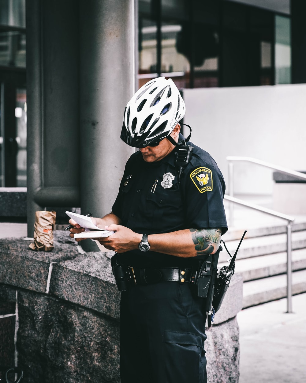 officer reading notes