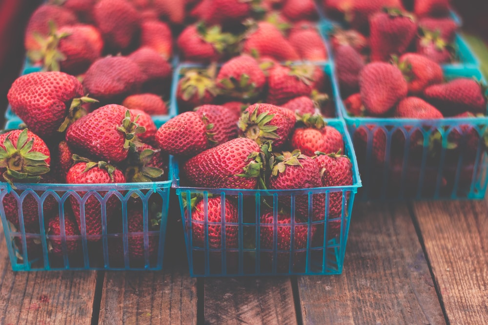 boxes of strawberries on table
