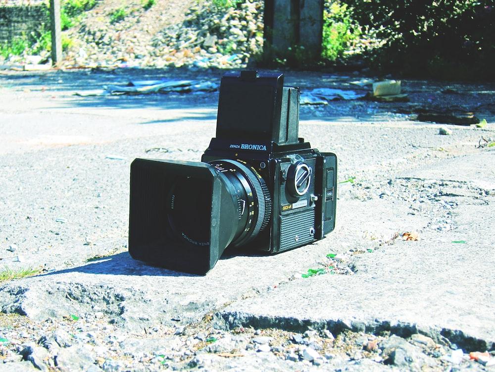 black camera on stone