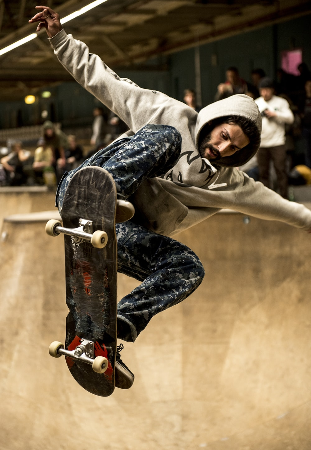 man riding skateboard and doing ollie trick