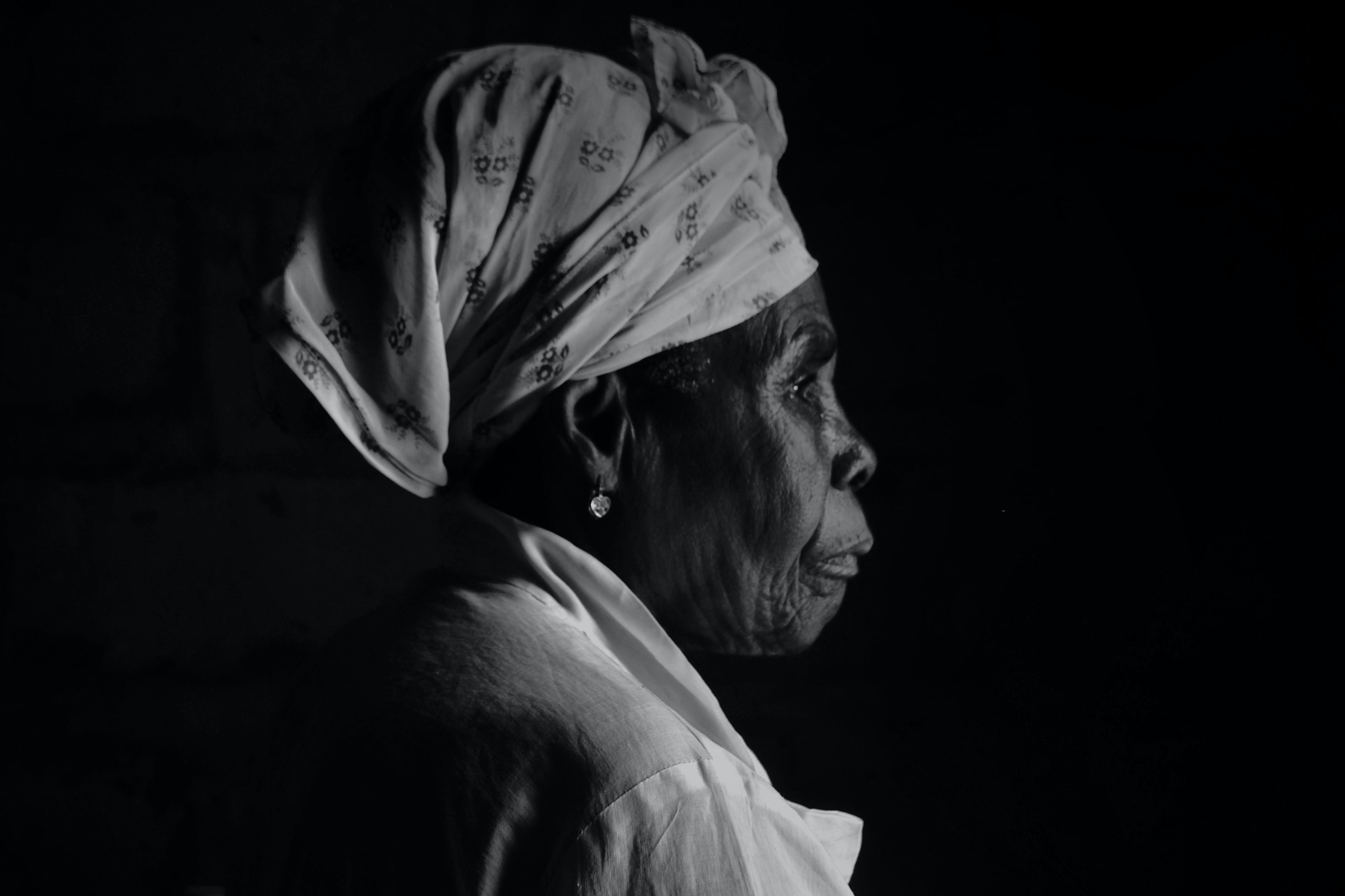 grayscale photo of woman wearing white turban