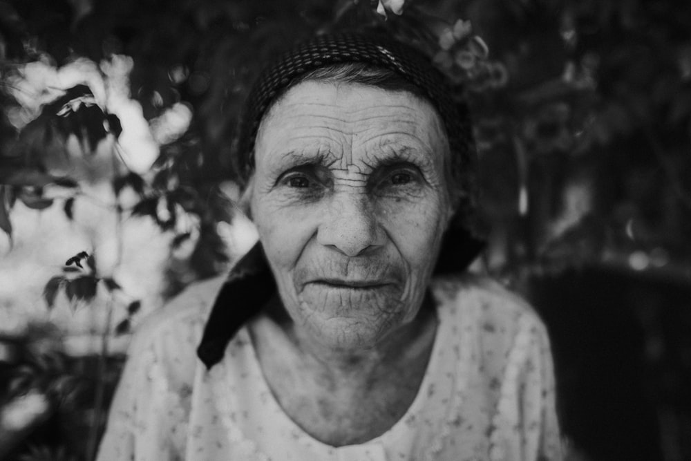 grayscale photo of a woman