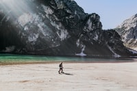 two people walks on beach