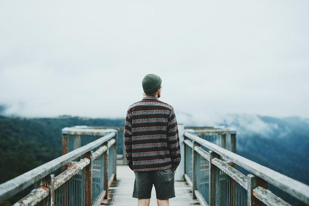 man standing on dock