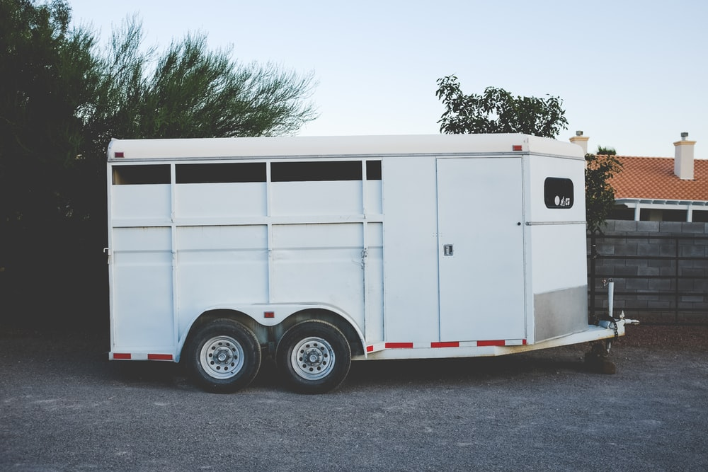 white enclosed vehicle trailer