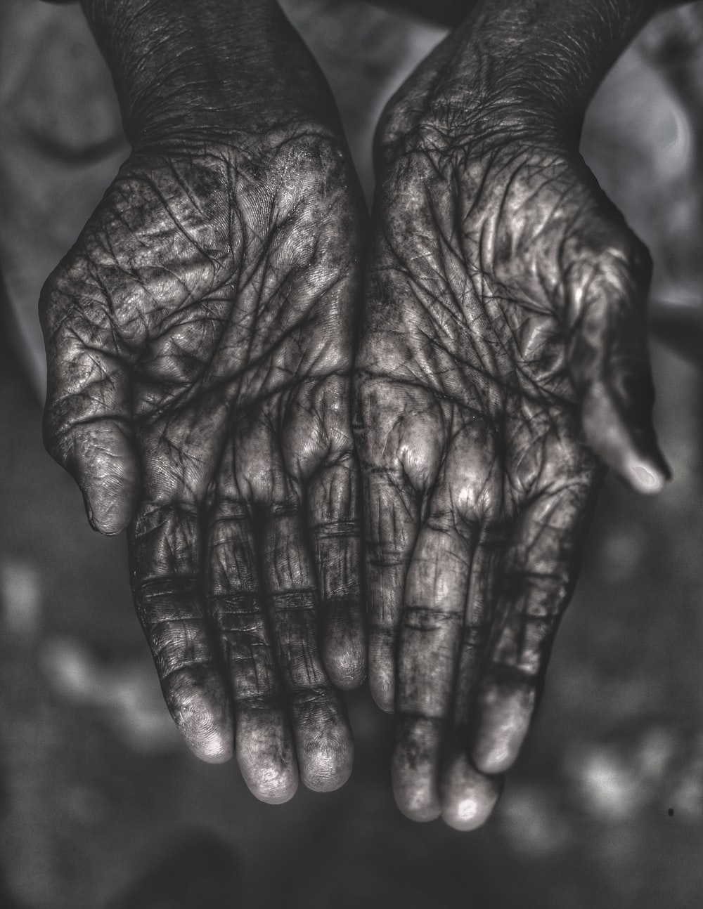 grayscale photo of human palms