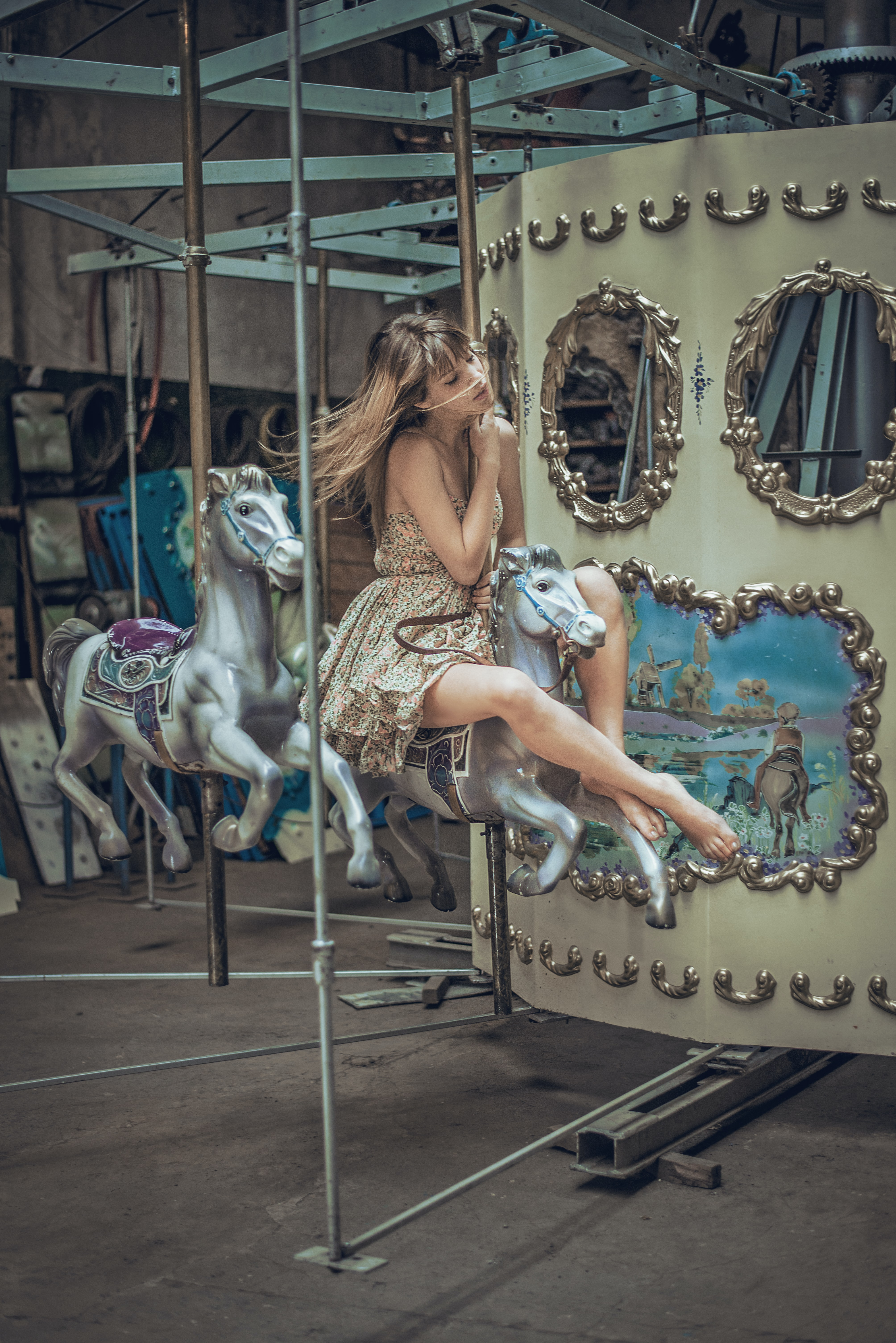 A woman wearing a party dress sitting on a carousel in Buenos Aires