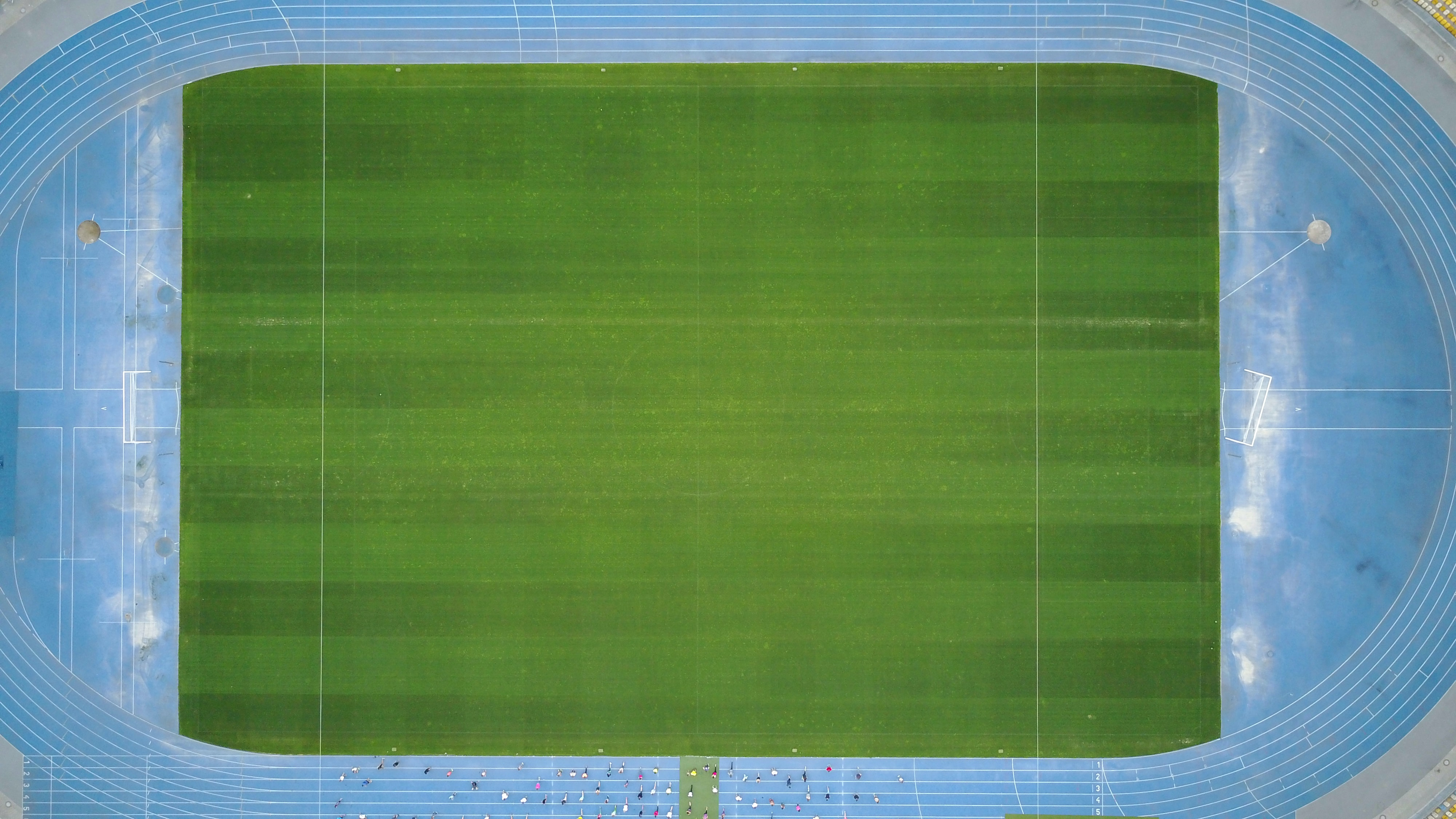 green and blue sport field poster