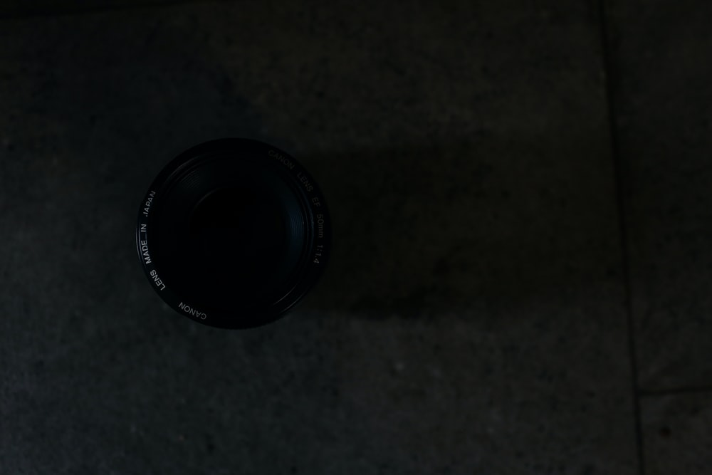 closeup photography of camera lens on floor tile