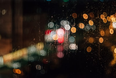 Lights behind a rainy window