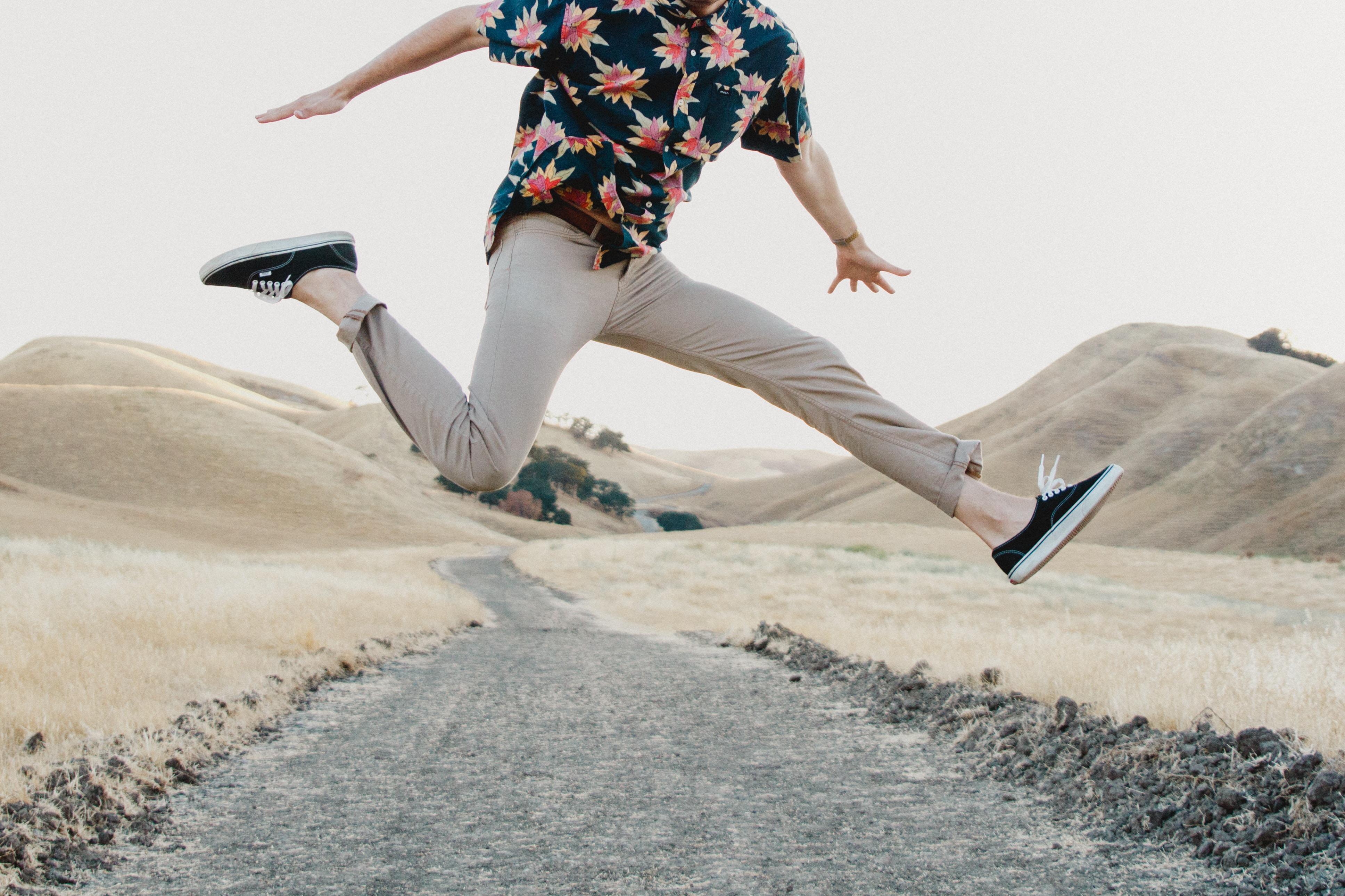 man in black shirt and gray pants jumping