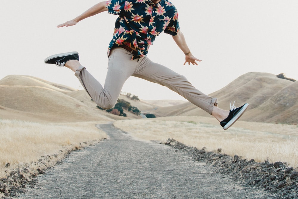 man in black shirt and gray pants jumping