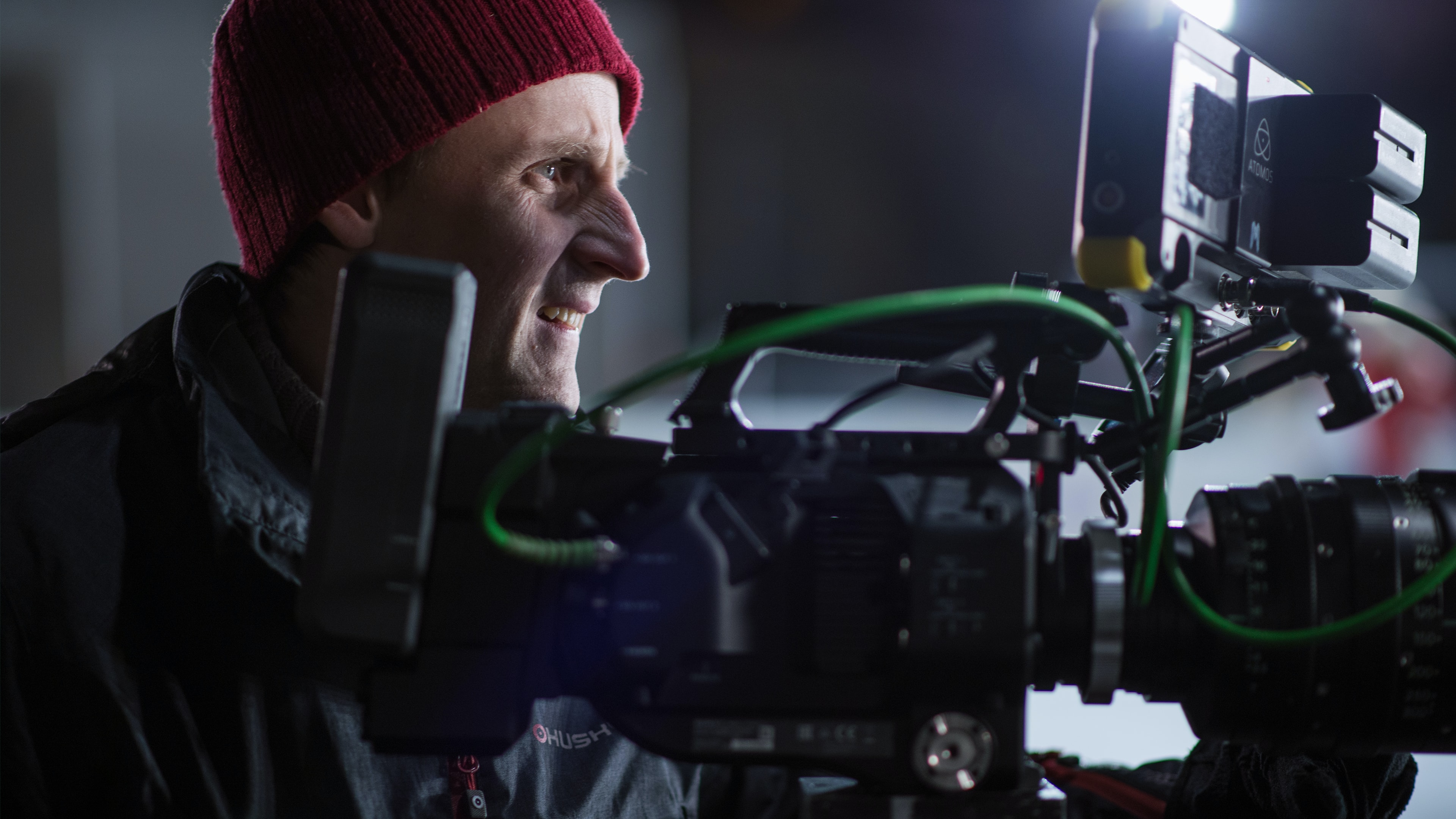 person facing black and gray professional camera