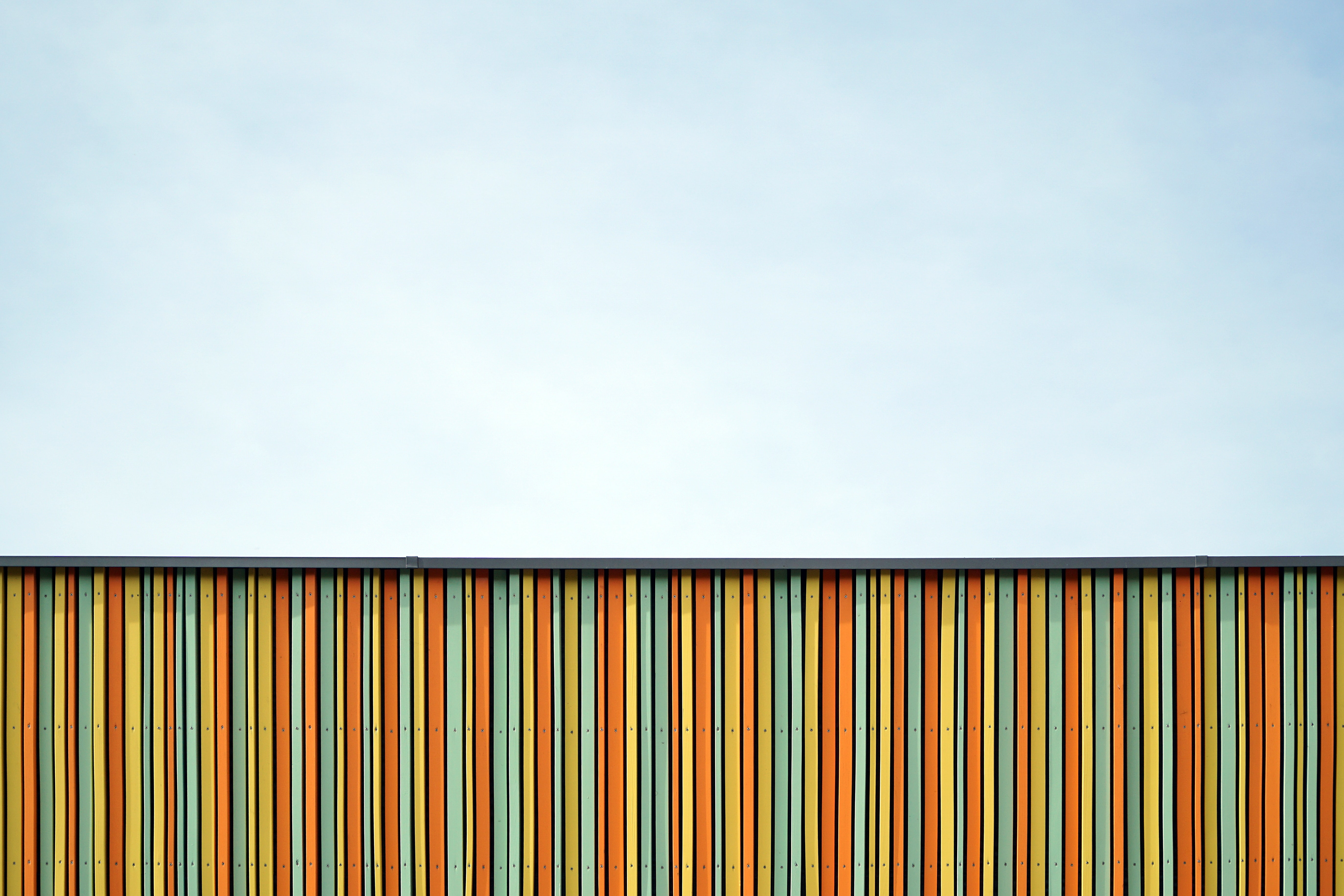 A colorful striped line facade and clouded skyline in Nuremberg, Bavaria in Germany