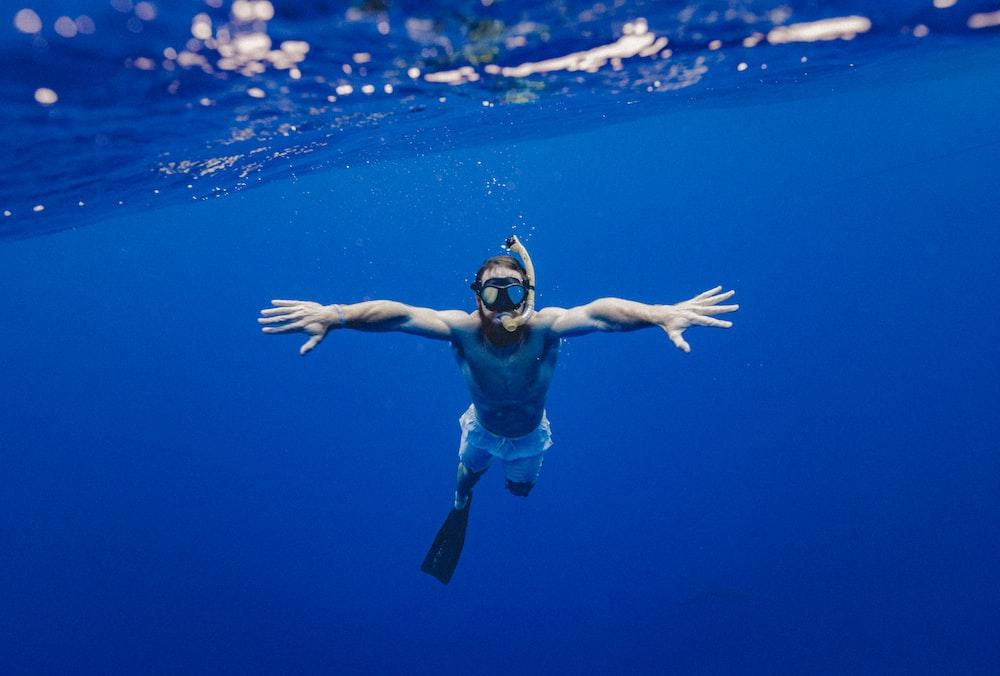 man snorkling underwater