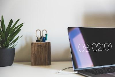 MacBook Air near brown wooden desktop organizer