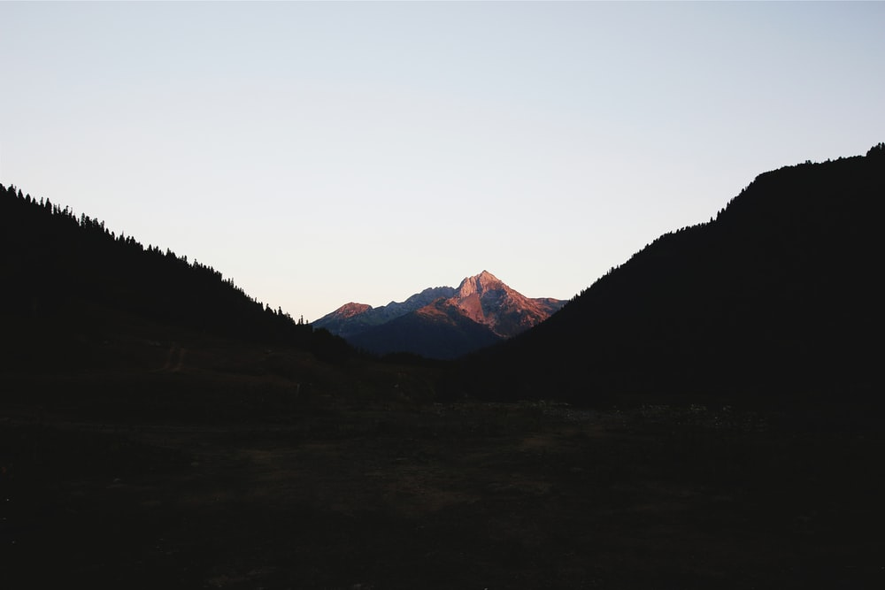 silhouette of valley and mountain
