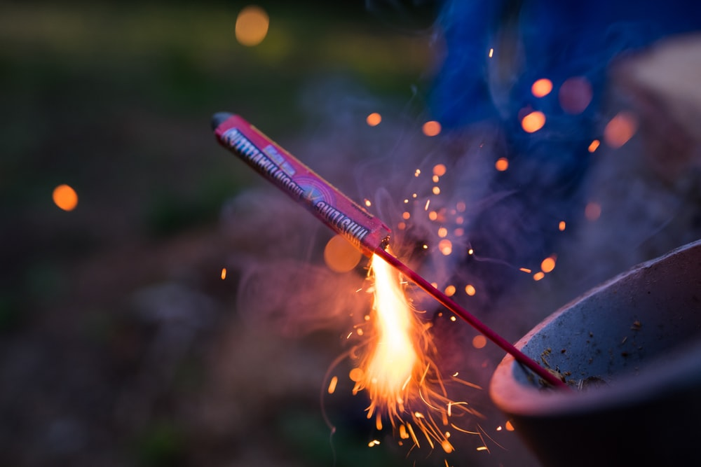 selective focus photography of lit firecracker