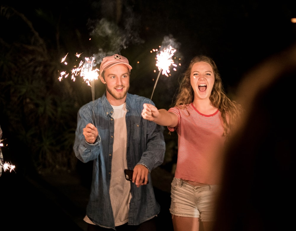man and woman holding firecracker